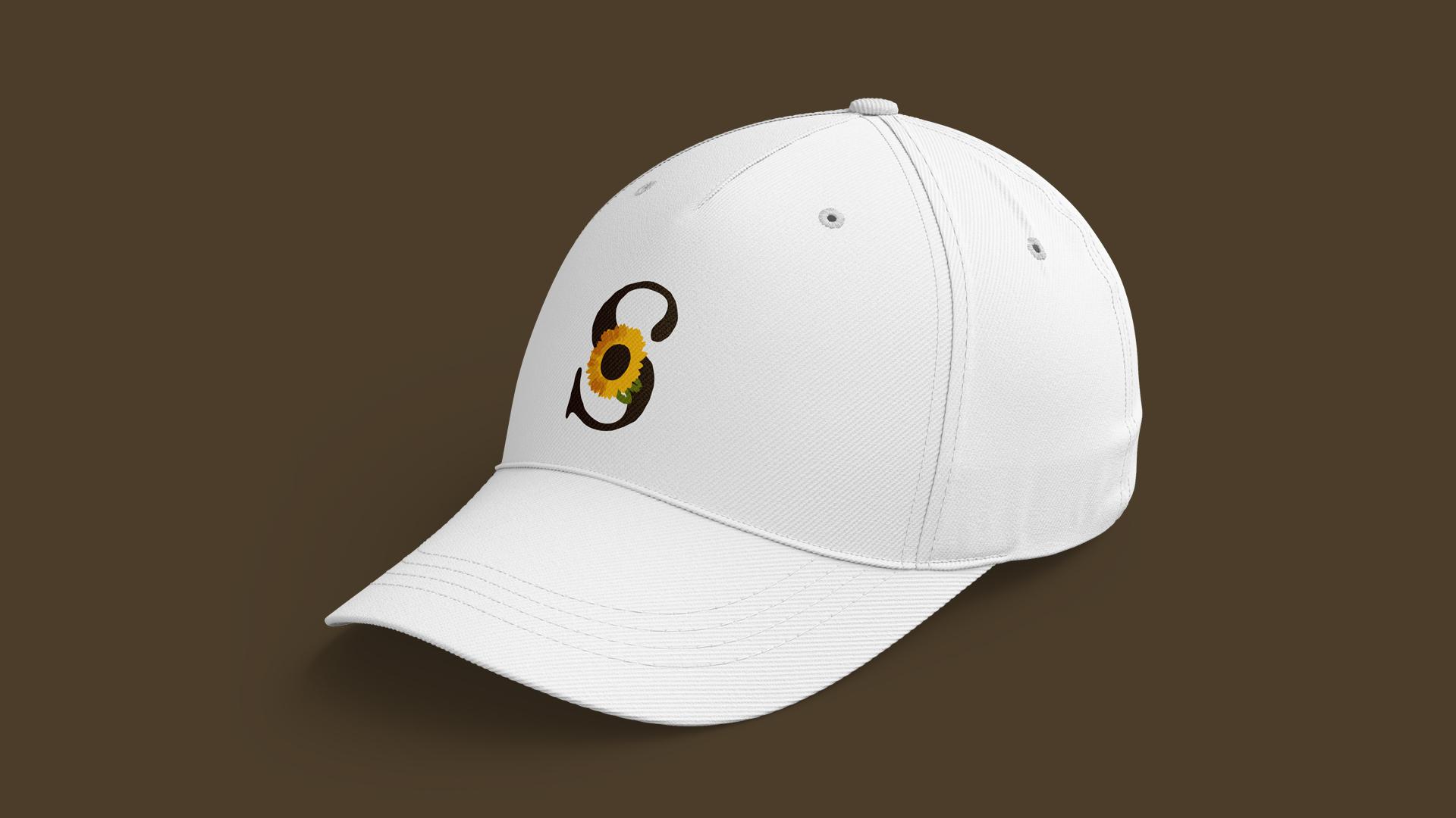 Wellness Brand Design secondary logo version on white cap